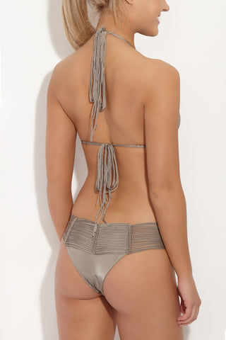 INDAH Fallen Macrame Cheeky Bikini Bottom - Taupe Brown Bikini Bottom | Taupe Brown| Indah Fallen Macrame Cheeky Bikini Bottom - Taupe Brown Mid-rise cheeky taupe bikini bottom with unique multi-string knot detail. Macrame-inspired cords meet in knotted vertical lines at front and back. Wide multi-strap waistband smoothes your curves and gives the bohemian bikini bottom a sexy finish. Sleek black lining ensures you're fully covered where you need to be under the peek-a-boo strands. Super cheeky Brazilian butt Back View