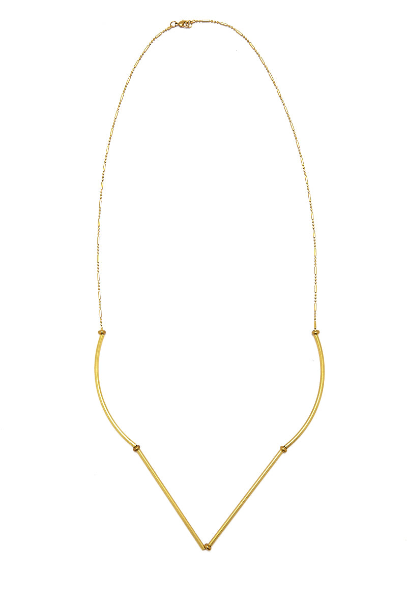 MASHALLAH Raw Geometric Necklace - Gold Jewelry   Mashallah Raw Geometric Necklace - Gold Long gold-tone brass chain necklace with curved recycled brass tube beads. Recycled brass tubes give the necklace a unique bubbled look. Small brass beads between tubes add a fine level of detail. Front View