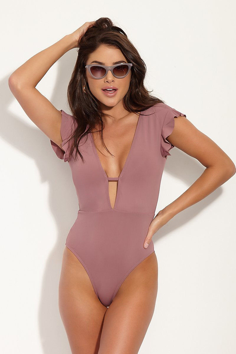 BETH RICHARDS Sophia Ruffled One Piece Swimsuit - Petal Pink One Piece | Petal Pink| Beth Richards Sophia Ruffled One Piece Swimsuit - Petal Pink.  Plunging V Neckline one piece. Short sleeve. Flowy ruffle detail at shoulder. Deep V-back. High cut leg. Moderate to full coverage. Lined. High quality Italian stretch fabric. UPF 50+ protection. Front View.