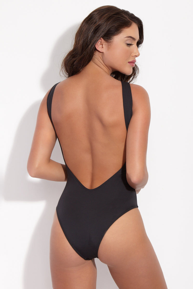 LA GOTTA Carina Cut Out One Piece - Scarlet Red/Black One Piece | Black| La Gotta Carina Cut Out One Piece - Black Back View Cut out One Piece Asymmetric Mesh Inserts High Scoop Neckline Low Scoop Back Cheeky Coverage