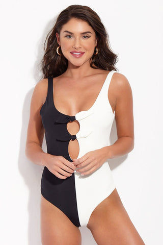 MARA HOFFMAN Maven One Piece - Black Cream One Piece | Black Cream| Mara Hoffman Maven One Piece Black and white color block one piece with scoop neckline and low scoop back. Front knot ties and open cut outs for peekaboo effect. Moderate coverage to full coverage.