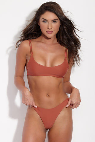 JADE SWIM Expose Low Rise Bikini Bottom - Terracotta Bikini Bottom | Terracotta| Jade Swim Expose Low Rise Bikini Bottom - Terracotta Front View Brownish-Red Terracotta Low-Rise Brazilian Cut Bikini Bottom Skimpy Front Coverage Cheeky Minimal Rear Coverage