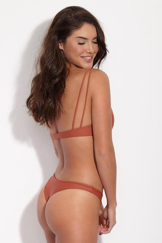 JADE SWIM Expose Low Rise Bikini Bottom - Terracotta Bikini Bottom | Terracotta| Jade Swim Expose Low Rise Bikini Bottom - Terracotta Side View Brownish-Red Terracotta Low-Rise Brazilian Cut Bikini Bottom Skimpy Front Coverage Cheeky Minimal Rear Coverage
