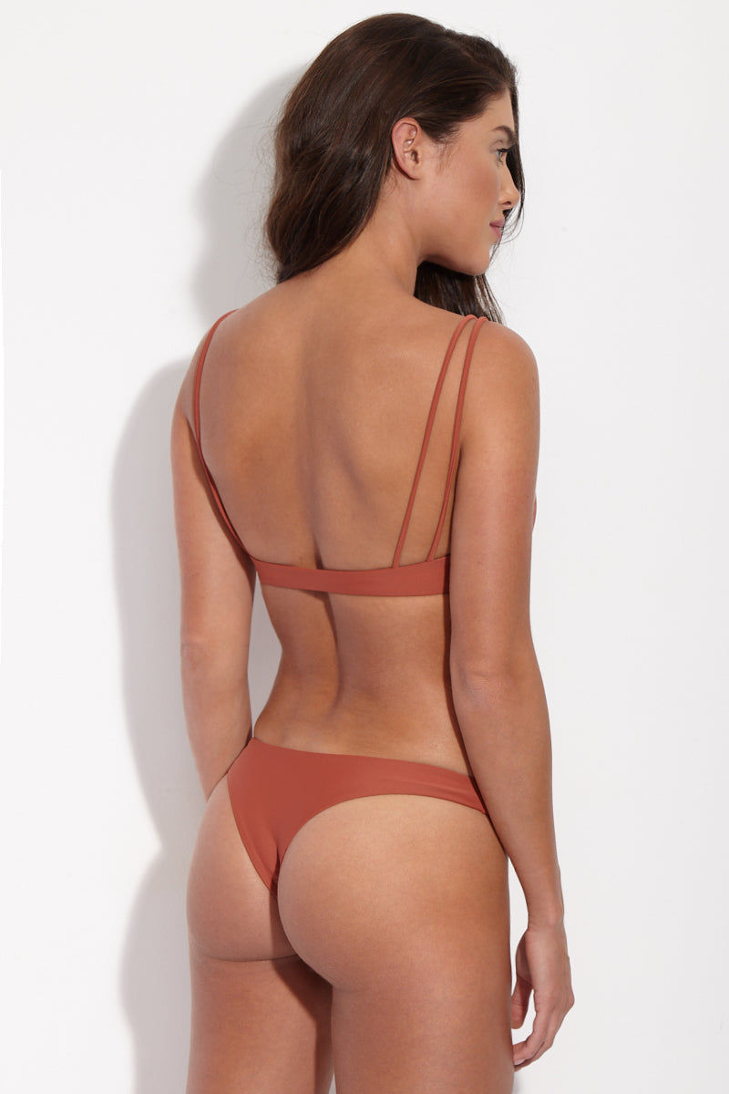JADE SWIM Expose Low Rise Bikini Bottom - Terracotta Bikini Bottom | Terracotta| Jade Swim Expose Low Rise Bikini Bottom - Terracotta Back View Brownish-Red Terracotta Low-Rise Brazilian Cut Bikini Bottom Skimpy Front Coverage Cheeky Minimal Rear Coverage