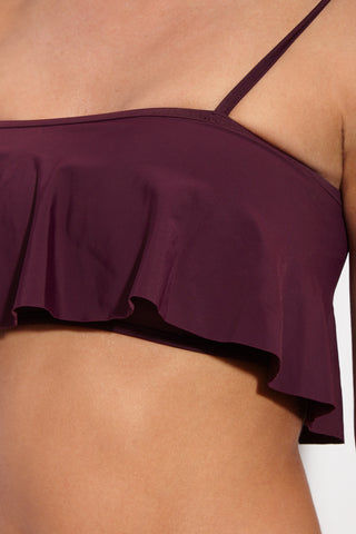 BETH RICHARDS Florence Flowy Bandeau Bikini Top - Port Purple Bikini Top | Port Purple| Beth Richards Florence Flowy Bandeau Bikini Top - Port. Front View. Bandeau bikini top. Removable shoulder tie straps. Flowly ruffle detail. High quality italian stretch fabric. Front View