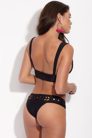 MGS Mermer Reversible Geometric Cut Out Bikini Bottom - Nude/Black Bikini Bottom | Nude/Black| MGS Mermer Reversible Geometric Cut Out Bikini Bottom - Nude/Black Mid-rise bikini bottom with geometric cut-out detailing in reversible nude and black. Pale beige side has colorblocked black contrast piping along band and edges. Black cut-out pattern Skimpy coverage Back View