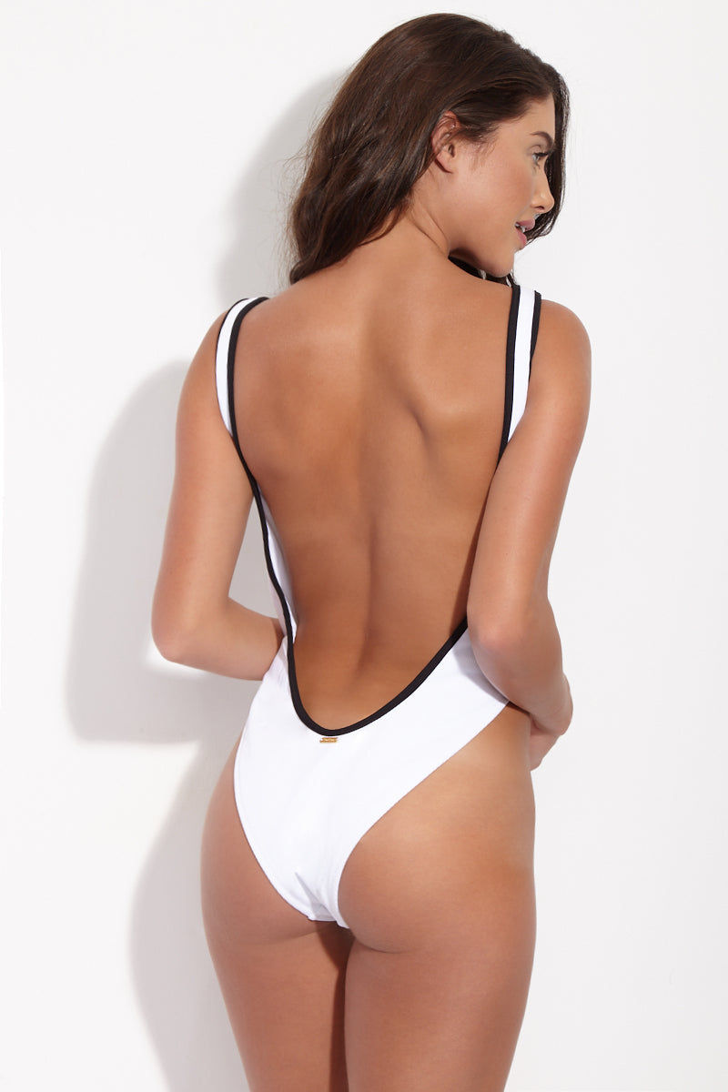 BEACH BUNNY Presley Sporty Button Up One Piece Swimsuit - White & Black One Piece | White & Black| Beach Bunny Presley Sporty Button Up One Piece Swimsuit - White & Black  Button-up white one piece swimsuit with black contrast detailing. Working snap buttons allow you to decide how much cleavage you reveal. Black and white color-blocked detail is super mod and perfectly on-trend. Scoop neck and super deep scoop back flatter your figure and show off your curves. High-cut leg with moderate rear coverage elongates your torso without being too cheeky. Back View