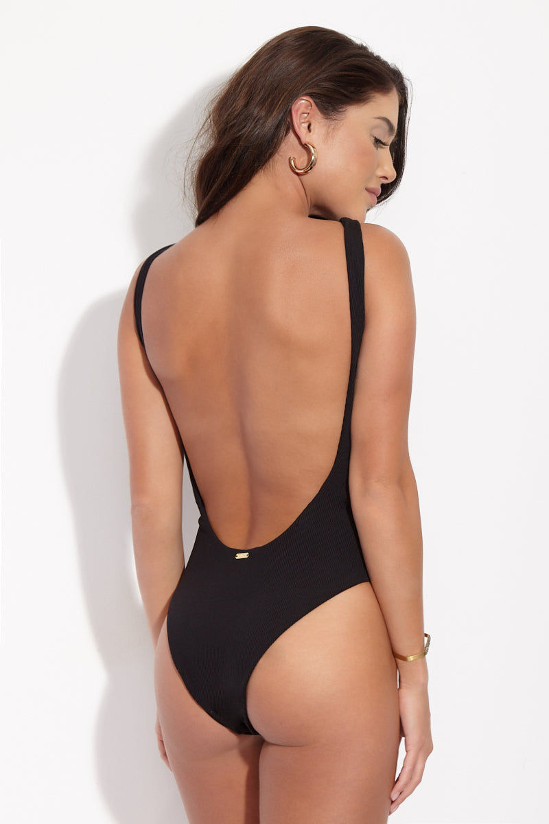 BEACH BUNNY Rib Tide Lace Up One Piece Swimsuit - Black One Piece | Black| Beach Bunny Rib Tide Lace Up One Piece - Black. Back view. Black lace up front one piece. High Neckline. High cut leg. Low scoop back. Moderate Coverage. Ribbed Fabric.