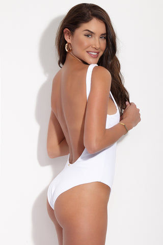 BEACH BUNNY Rib Tide Lace Up One Piece Swimsuit - White One Piece | White| Beach Bunny Rib Tide Lace Up One Piece - White. Side View. High neckline. High cut leg. Low scoop back. Moderate Coverage. Ribbed Fabric.