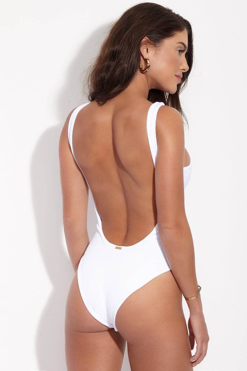 BEACH BUNNY Rib Tide Lace Up One Piece Swimsuit - White One Piece | White| Beach Bunny Rib Tide Lace Up One Piece - White. Back View. High neckline. High cut leg. Low scoop back. Moderate Coverage. Ribbed Fabric.