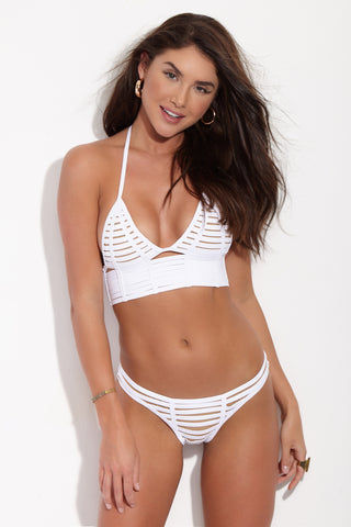 BEACH BUNNY Hard Summer Cheeky Cut Out Bikini Bottom - White Bikini Bottom | White| Beach Bunny Hard Summer Cheeky Cut Out Bikini Bottom - White. Front View. Low rise white bikini bottom with sexy cut-out binding at front. Edgy strappy detail is fully lined with nude fabric so the see-through effect is just an illusion. Ruched scrunch back panel accentuates and flatters your booty while providing moderate rear coverage.