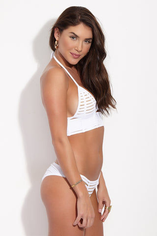 BEACH BUNNY Hard Summer Cheeky Cut Out Bikini Bottom - White Bikini Bottom | White| Beach Bunny Hard Summer Cheeky Cut Out Bikini Bottom - White. Side View. Low rise white bikini bottom with sexy cut-out binding at front. Edgy strappy detail is fully lined with nude fabric so the see-through effect is just an illusion. Ruched scrunch back panel accentuates and flatters your booty while providing moderate rear coverage.