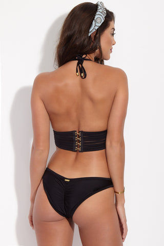 BEACH BUNNY Hard Summer Triangle Bikini Top - Black Bikini Top | Black| Beach Bunny Hard Summer Triangle Bikini Top - Black. Back View. Back longline triangle bikini top with sexy all-over-cut -out binding. Edgy strappy binding is fully lined with nude fabric so the see-through effect is just an illusion. Extra-wide bra band secures at back with quadruple hook & eye closure that gives the risque finish of a bustier top.