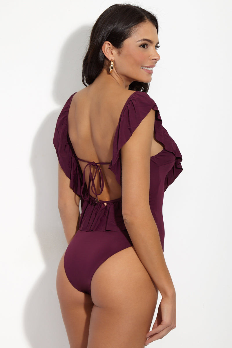 RADIO FIJI Wayalife Ruffle One Piece - Sangria One Piece | Sangria| Radio Fiji Wayalife Ruffle One Piece - Sangria Back Side View. Deep Scoop Neckline. Ruffle Neck Detail. Ties at Center Back. High cut leg. Cheeky Coverage. Matte Jersey Material