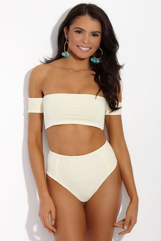 SIE SWIM Chloe Off The Shoulder Bandeau Bikini Top - Ivory Bikini Top | Ivory| SIE SWIM Chloe Off The Shoulder Bandeau Bikini Top - Ivory. Front View. White Bandeau-style bikini top with off-the-shoulder bardot sleeves. Elegant ivory white fabric is fully lined in luxe rose gold. Adjustable thick tie closure at back keeps you supported and secure all day.
