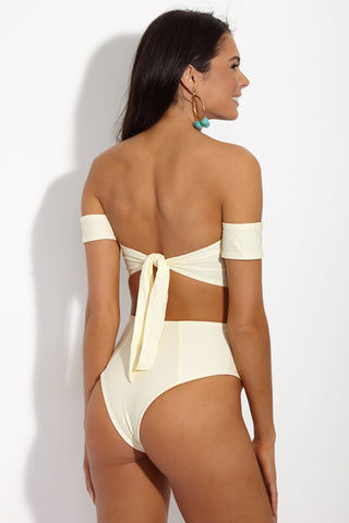 SIE SWIM Chloe Off The Shoulder Bandeau Bikini Top - Ivory Bikini Top | Ivory| SIE SWIM Chloe Off The Shoulder Bandeau Bikini Top - Ivory. Back View. White Bandeau-style bikini top with off-the-shoulder bardot sleeves. Elegant ivory white fabric is fully lined in luxe rose gold. Adjustable thick tie closure at back keeps you supported and secure all day.
