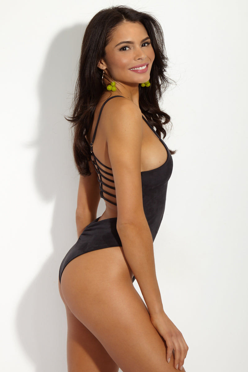 MONTCE SWIM Cage Plunging High Cut One Piece Swimsuit - Black Faux Suede One Piece | Black Faux Suede|MONTCE SWIM Cage Plunging High Cut One Piece Swimsuit - Black Faux Suede. Features: Plunging black faux suede one piece swimsuit with horizontal cage-like detail. The Cage One Piece is Montce's best-selling swimsuit and the luxe leather look takes it to the next level. Side View
