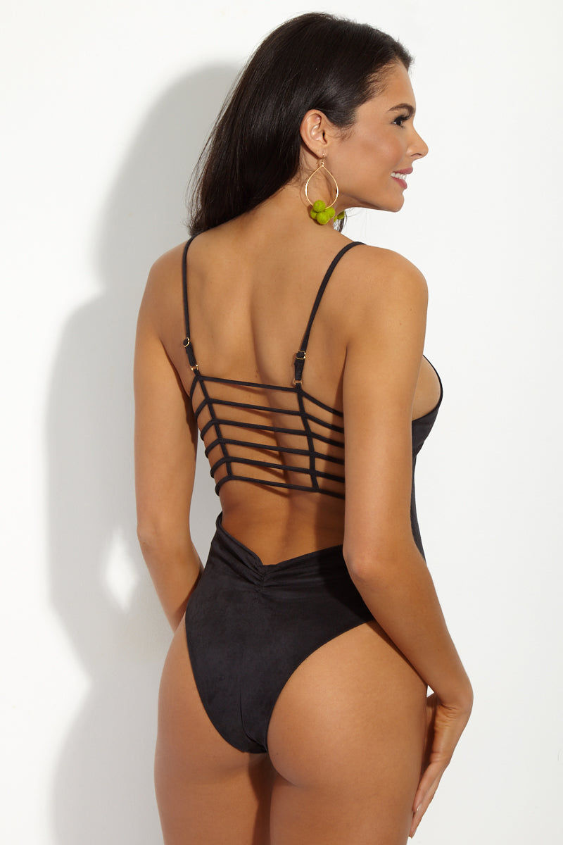 MONTCE SWIM Cage Plunging High Cut One Piece Swimsuit - Black Faux Suede One Piece | Black Faux Suede|MONTCE SWIM Cage Plunging High Cut One Piece Swimsuit - Black Faux Suede. Features: Plunging black faux suede one piece swimsuit with horizontal cage-like detail. The Cage One Piece is Montce's best-selling swimsuit and the luxe leather look takes it to the next level. Back View