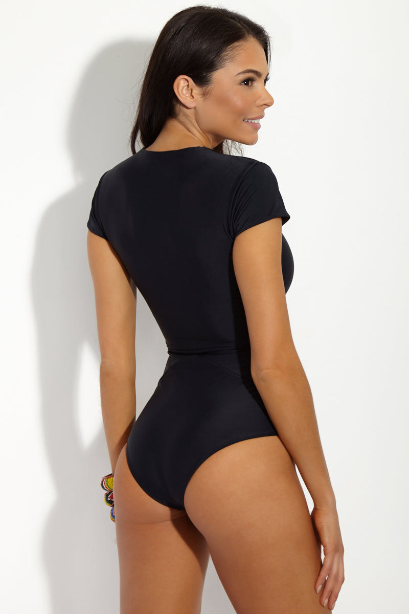 ACACIA Veracruz Lace Up One Piece Swimsuit - Black Beauty One Piece   Black Beauty  Acacia VeracruzVeracruz Lace Up One Piece Swimsuit - Black Beauty. Features: V-Neckline. Lace Up Chest Detail. Short Cap-shoulder sleeves. Center cut out detail. Cheeky Coverage. View: Back view.