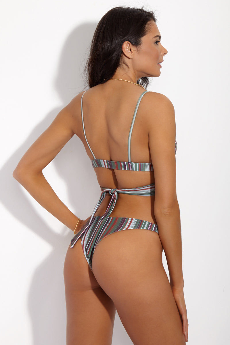 SIE SWIM Kyle Twist Wrap Bikini Top - Stripe Print Bikini Top | Stripe Print| SIE SWIM Kyle Twist Wrap Bikini Top - Stripe Print. Back View. Plunging twist-front wrap bikini top in cool-toned stripe print. Fabric twists at front and around back for a flattering, high-fashion wrap effect. Spaghetti straps and wide band add just the right amount of support to the bikini top. Seamless design offers ultimate comfort. Wearp as a crop top with your favorite high-waisted pants for a chic street look. Complete the bikini with the SIE Swim Stripe Print Madison Bikini Bottom.