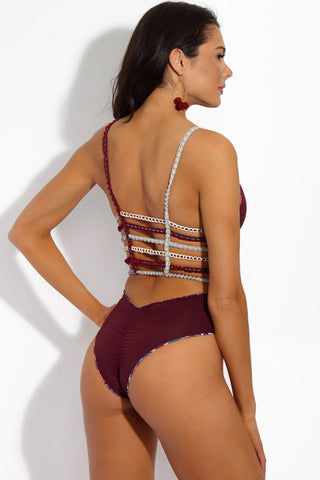 CAPITTANA Chiara Burgundy Reversible One Piece One Piece | Chiara/ Burgundy| Capittana Chiara Burgundy Reversible One Piece back view solid side Burgundy geometric pattern crochet strappy reversible one piece swimsuit.