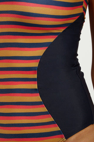 SEEA Lola Scoop Neck Color Blocked Moderate One Piece Swimsuit - Sunset Print One Piece | Sunset| Seea Lola One Piece Classic tank-style one piece swimsuit. Multicolor horizontal stripe pattern. Navy color blocking at each side of the waist. Scoop back. High leg cut. Cheeky coverage to moderate coverage.