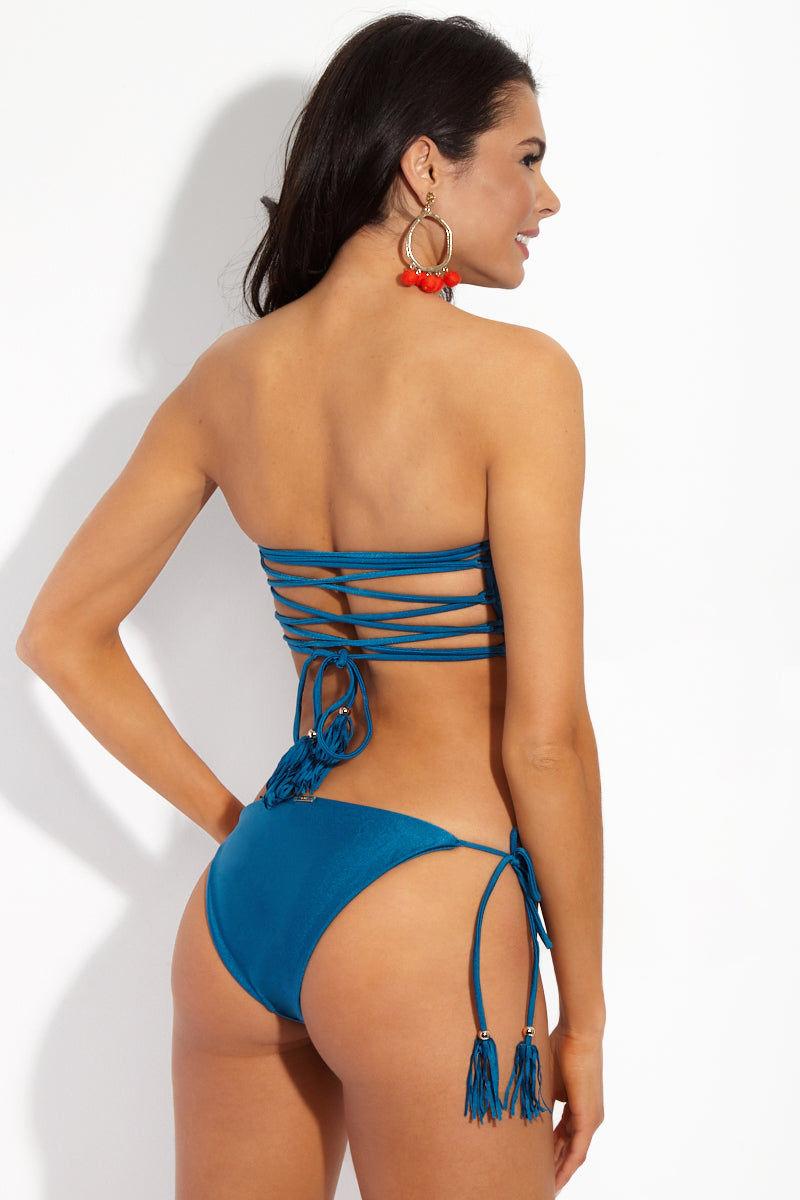 YSHEY Rachel Neptuno Bottom Bikini Bottom | Deep Blue| YSHEY Rachel Neptuno Bottom - Back view Classic tassel tie side bikini bottom in eye-catching metallic blue fabric.