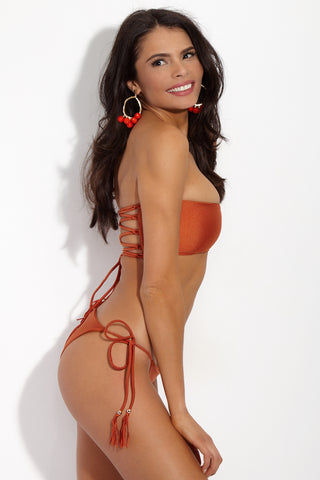 YSHEY Rachel Duchesse Bottom Bikini Bottom | Rusty Orange| YSHEY Rachel Duchesse Bottom - side view Classic tassel tie side bikini bottom in eye-catching metallic orange fabric.