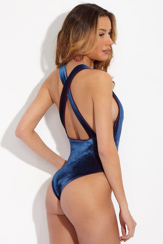SARA CRISTINA Dream Velvet Plunging Criss Cross Back One Piece Swimsuit - Deep Sea Blue One Piece | Deep Sea Blue| Sara Cristina Dream Velvet Plunging Criss Cross Back One Piece Swimsuit - Deep Sea Blue  Luxurious navy blue plush velvet one piece swimsuit. Deep plunging neckline. Thick straps cascade into criss cross back detail. Peekaboo raspberry red lining. Cheeky coverage. High-cut leg. Back View