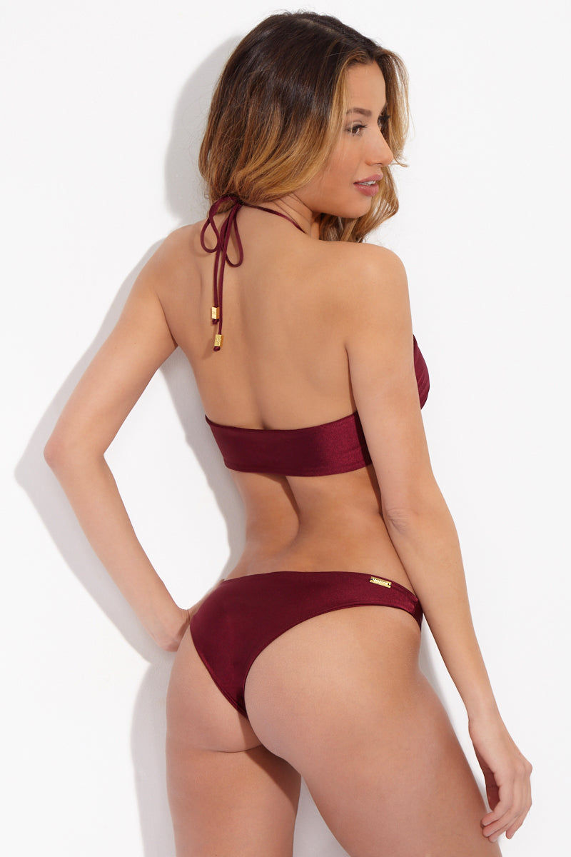 SARA CRISTINA Ola Low Rise Cheeky  Bikini Bottom - Burgundy Red Bikini Bottom | Burgundy Red| Sara Cristina Ola Low Rise Cheeky  Bikini Bottom - Burgundy Red Elegant, luxurious burgundy bikini bottom with a little sheen. Low-rise cut. Cheeky to moderate coverage. Gold-plated logo at back. Back View