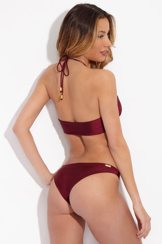 SARA CRISTINA OLA Low Rise Bikini Bottom - Red Bikini Bottom | Red| Sara Cristina OLA Bikini Bottom Elegant, luxurious burgundy bikini bottom with a little sheen. Low-rise cut. Cheeky to moderate coverage. Gold-plated logo at back.