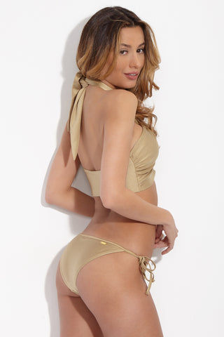 SARA CRISTINA Gold Knot Bikini Bottom Bikini Bottom | Gold| Sara Cristina Gold Knot Bikini Bottom Antique gold bikini bottom. Adjustable side ties. Gold-plated logo sewn onto back hemline. Low-rise cut. Fully lined in high-end Italian Lycra. Cheeky to moderate coverage.