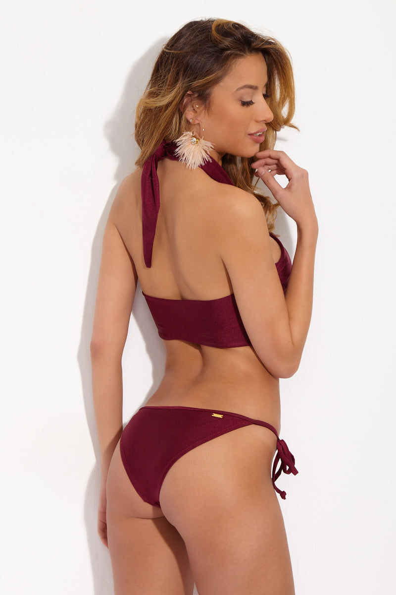 SARA CRISTINA Burgundy Knot Bikini Bottom Bikini Bottom | Burgundy| Sara Cristina Burgundy Knot Bikini Bottom Luxurious burgundy bikini bottom. Adjustable side ties. Gold logo sewn onto back hemline. Cheeky to moderate coverage.