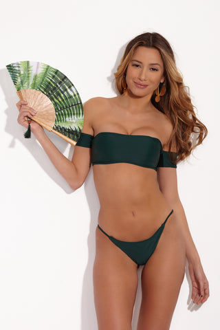 STONE FOX SWIM Irie Side Strap Bikini Bottom - Rainforest Green Bikini Bottom | Rainforest Green| Stone Fox Swim IIrie Side Strap Bottom - Rainforest Green Front View. Forest green bikini bottom with thin side straps. Cheeky to moderate coverage.