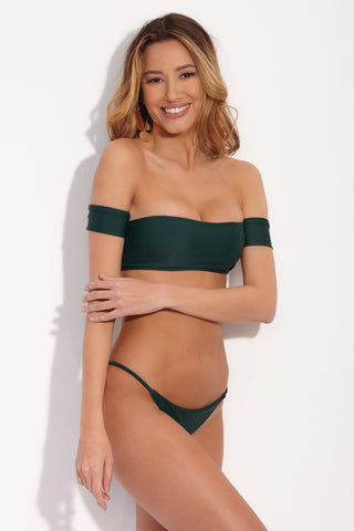 STONE FOX SWIM Irie Side Strap Bikini Bottom - Rainforest Green Bikini Bottom | Rainforest Green| Stone Fox Swim IIrie Side Strap Bottom - Rainforest Green Front SIde View. Forest green bikini bottom with thin side straps. Cheeky to moderate coverage.