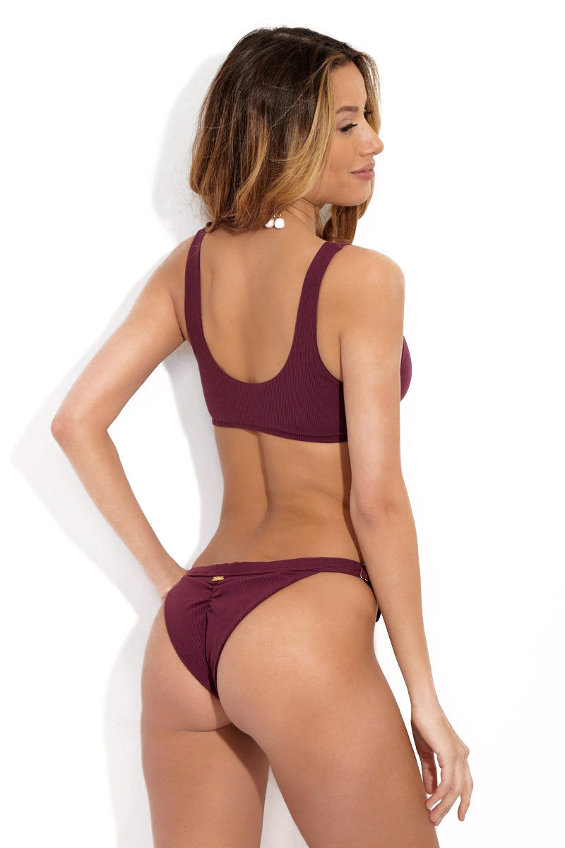 BEACH BUNNY Rib Tide Cheeky Hipster Bikini Bottom - Plum Bikini Bottom | Plum| Back View of Beach Bunny Rib Tide Cheeky Hipster Bikini Bottom - Plum with Cheeky Coverage, Ruched Butt, and Adjustable Side Straps