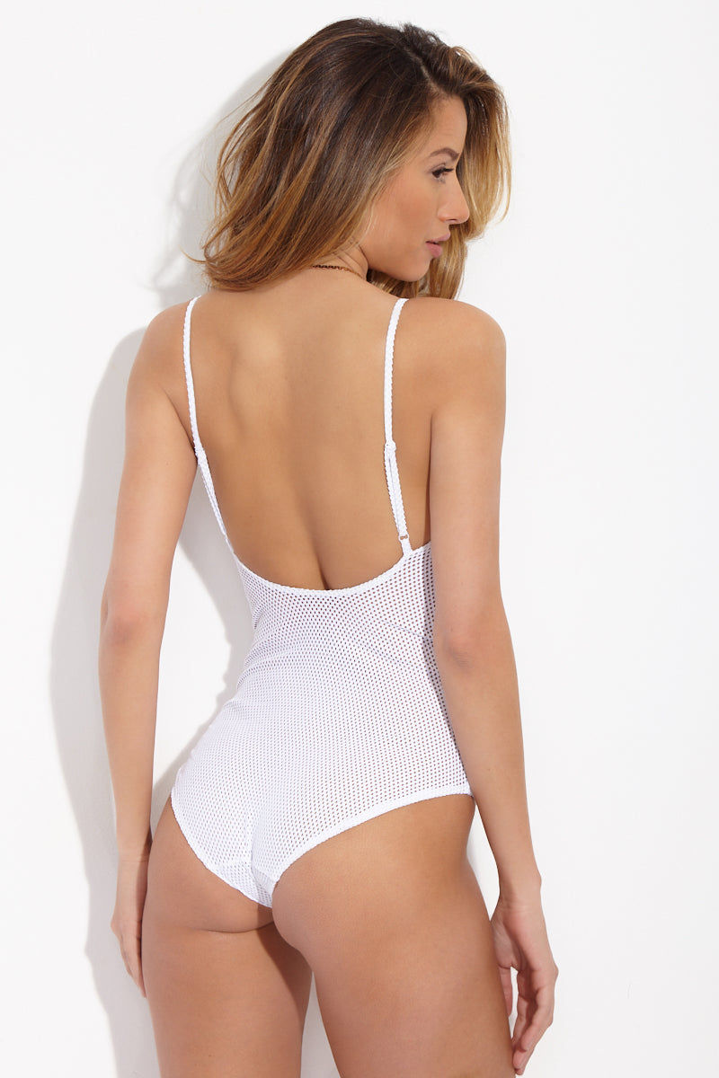 ONIA Arianna Sporty Scoop Back One Piece - Mesh Solid White One Piece | Mesh Solid White| ONIA Arianna Sporty Scoop Back One Piece - Mesh Solid White. Features:  White one piece swimsuit in high-quality mesh fabric with front half-zip closure. Sporty mesh and playful zipper give the suit an athletic feel. Feminine V-neck, adjustable spaghetti straps, moderate scoop back, and subtly cheeky bottom add elegant balance. View:  On model, back view.