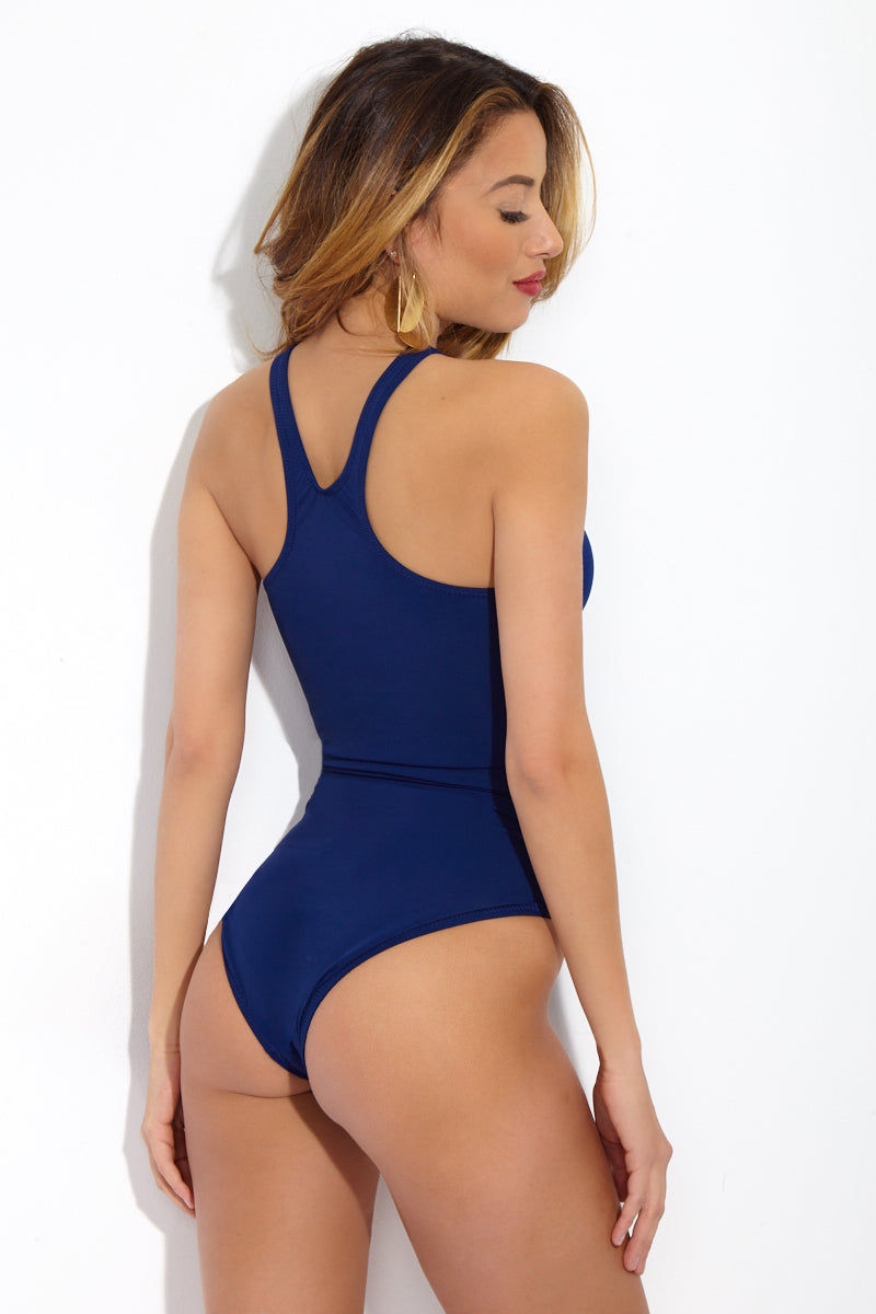 NORMA KAMALI Sporty Racerback Mio One Piece Swimsuit - Navy Blue One Piece | Navy Blue|  Norma Kamali Sporty Racerback Mio One Piece Swimsuit - Navy Blue The sporty chic, versatile one piece can be worn as a swimsuit or as a sleek bodysuit. Tank-style mini scoop neck flatters your natural form without any padding. Sharp racerback shows off your shoulders and gives every moment an air of athleticism. High-cut leg elongates your frame while providing moderate rear coverage. Back View