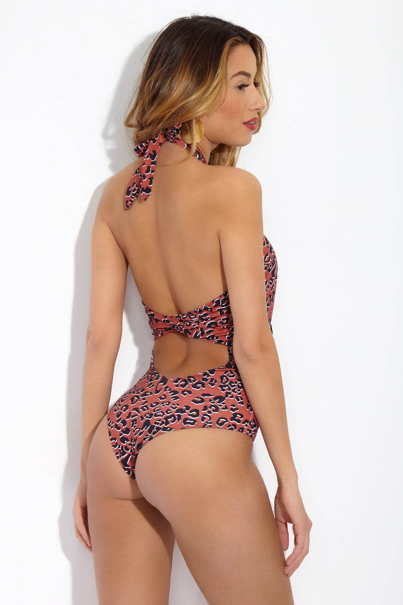 BEACH RIOT Cori Tasseled Cross Front Halter One Piece Swimsuit - Leopard Print One Piece | Leopard Print|Beach Riot Cori Tasseled Cross Front Halter One Piece Swimsuit - Leopard Print  Front cut out with tassel detail. High cut leg. Adjustable halter ties. Back cut out. Cheeky coverage. Back View
