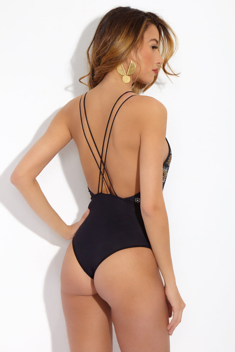 BEACH RIOT Eclipse Deep V One Piece Swimsuit - Zodiac Moon One Piece | Zodiac Moon| Beach Riot Eclipse Deep V One Piece Swimsuit - Zodiac Moon. Back View.one piece with deep plunging neckline. Silver and gold studs in zodiac moon design. Strappy detail down the torso. Criss cross back. Cheeky coverage.