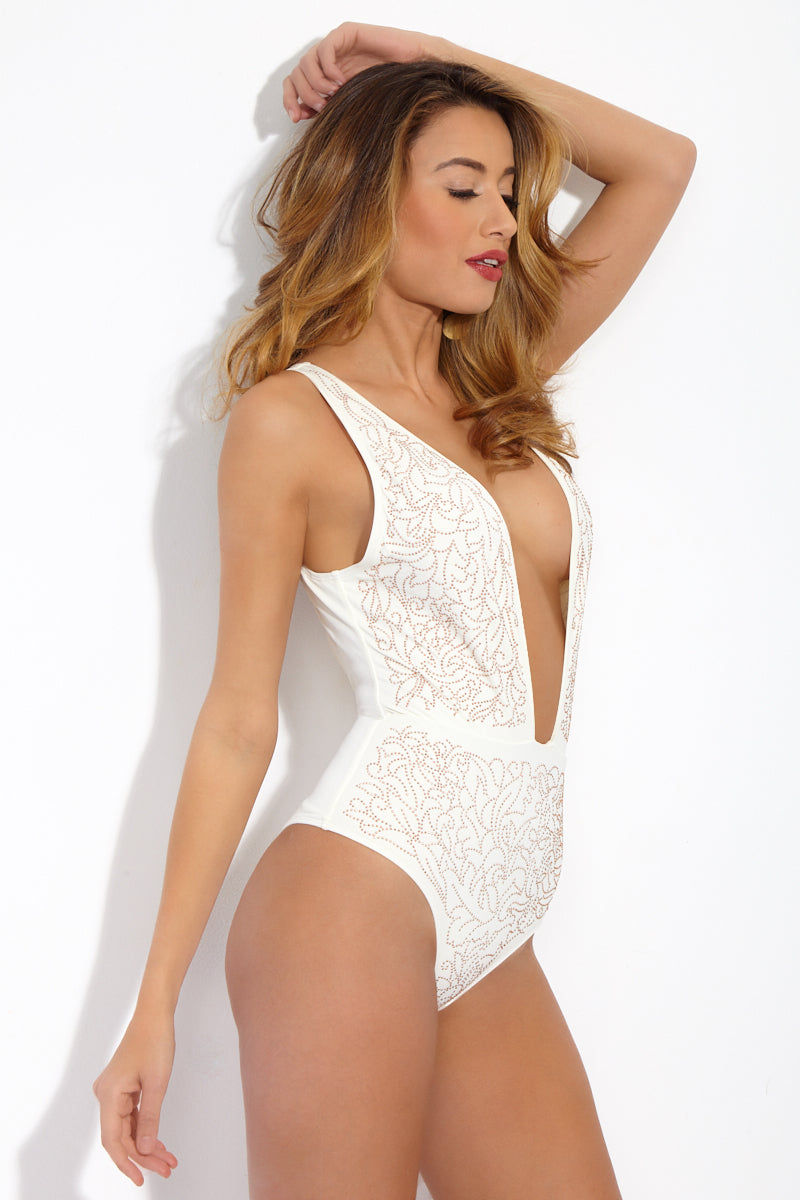 BEACH RIOT Ibiza Deep V One Piece Swimsuit- Roses N Cream One Piece | Roses N Cream | Beach Riot Ibiza Deep V One Piece Swimsuit- Roses N Cream. Side View one piece with deep plunging neckline. Horizontal seam at waistline. Rose gold stud embellishments. Low open back. Cheeky coverage.
