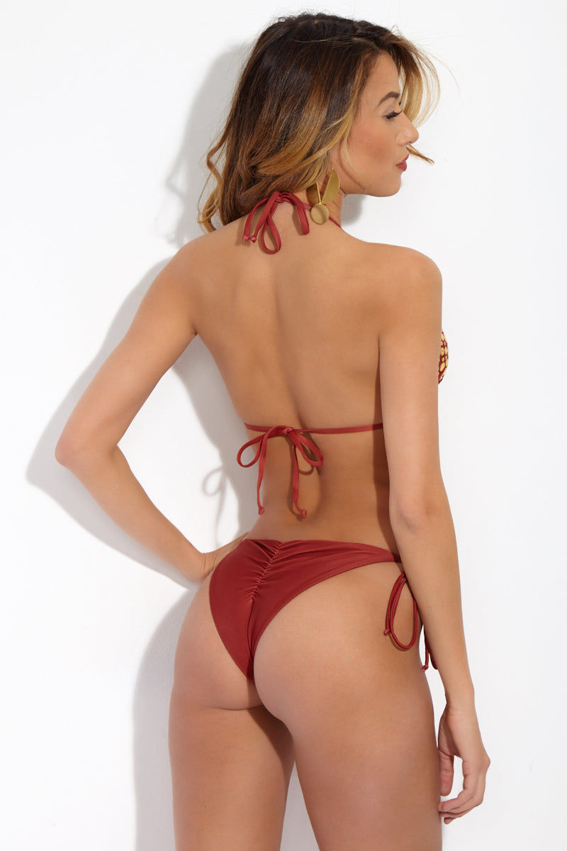BEACH RIOT Lola Studded Triangle Bikini Top - Fiery Sienna Red Bikini Top | Fiery Sienna Red| Beach Riot Lola Studded Triangle Bikini Top - Fiery Sienna Red Burnt-red triangle bikini top. Gold stud detailing across triangle cups. Halter ties at neck. Adjustable ties at back. Back View