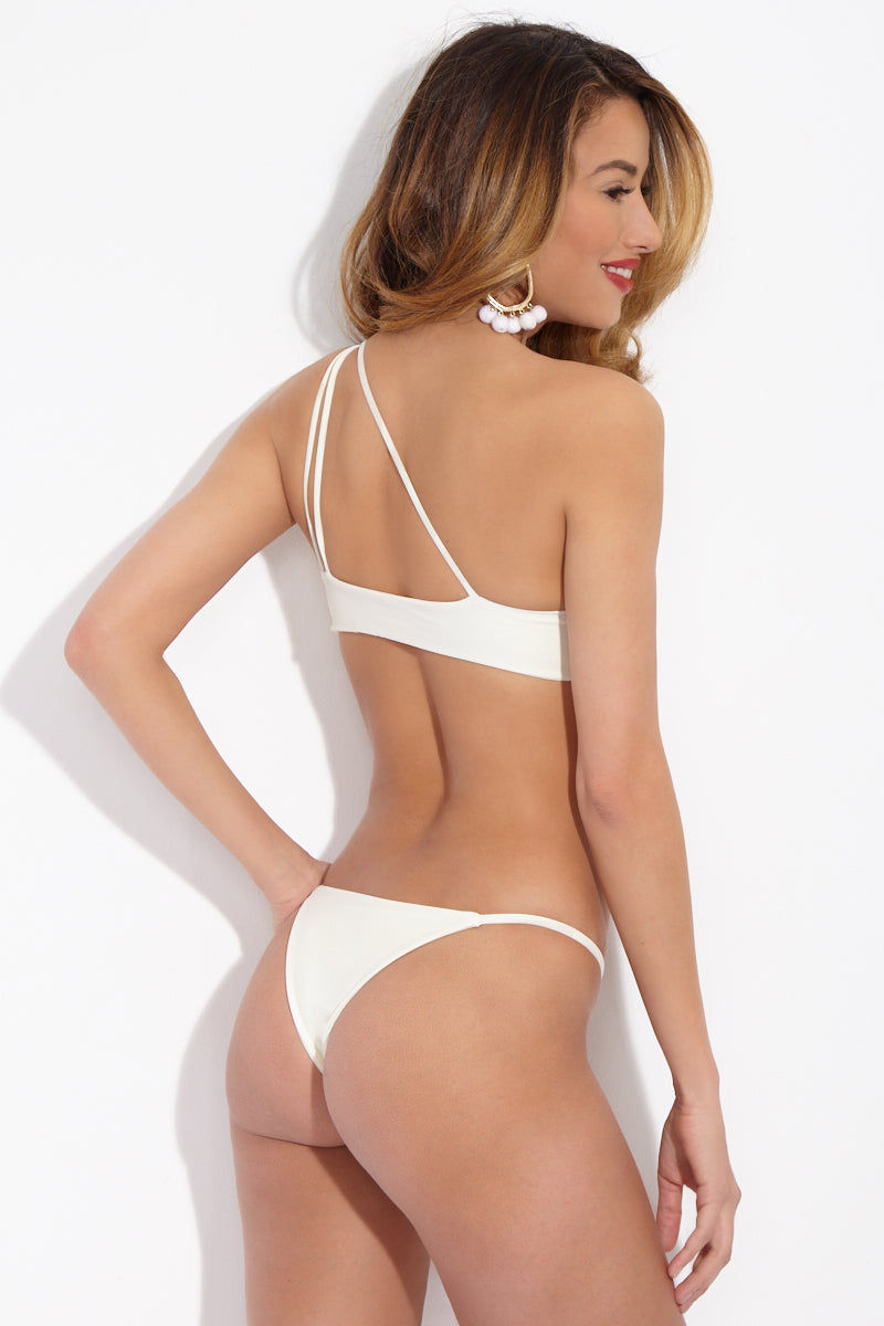 MIKOH Sao Paulo Classic String Bikini Bottom - Bone White Bikini Bottom | Bone White| Mikoh Sao Paulo Classic String Bikini Bottom - Bone White. Features: Classic skimpy string bikini bottom. Low rise cut and thin side straps leave less noticeable tan lines. Seamless and hardware-free, this bikini bottom is perfect for all-day, fuss-free wear. Back View