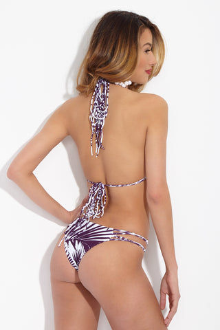 MIKOH Molokai Strappy Low Rise Bikini Bottom - Botanical Wine Purple Print Bikini Bottom | Botanical Wine Purple Print| Mikoh Molokai Strappy Low Rise Bikini Bottom - Botanical Wine Purple Print. Features: Low rise strappy cheeky bikini bottom. Delicately accented with a knotted string side detail to show some skin at the hips. Low rise cut and minimal coverage leave less noticeable tan lines. Back View
