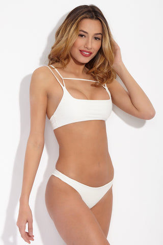 MIKOH Lahaina Low Rise Seamless Bikini Bottom - Bone White Bikini Bottom | Bone White| Mikoh Lahaina Low Rise Seamless Bikini Bottom - Bone White Features: Low Rise skimpy minimalist bikini bottom. Wide side straps can be hiked up at the hips to create the appearance of elongated legs. Seamless and hardware-free. Front View