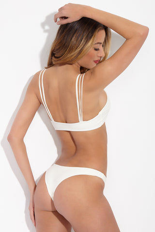 MIKOH Lahaina Low Rise Seamless Bikini Bottom - Bone White Bikini Bottom | Bone White| Mikoh Lahaina Low Rise Seamless Bikini Bottom - Bone White Features: Low Rise skimpy minimalist bikini bottom. Wide side straps can be hiked up at the hips to create the appearance of elongated legs. Seamless and hardware-free. Back View