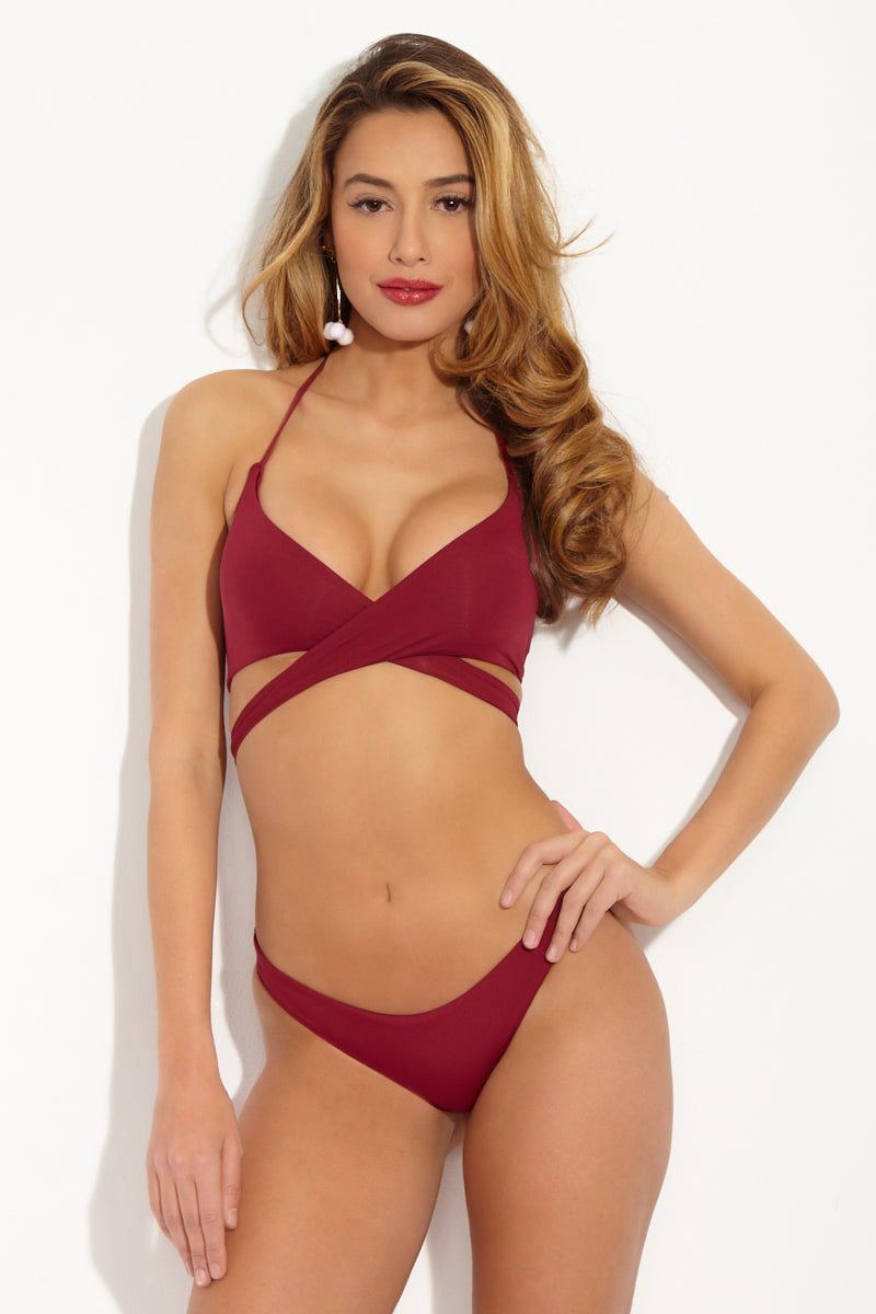 FRANKIES BIKINIS Charlie Cheeky Bikini Bottom - Maroon Red Bikini Bottom | Maroon Red| Frankies Bikinis Charlie Cheeky Bikini Bottom - Maroon Red Seamless bottom Cheeky coverage  79% Nylon, 21% Spandex  Front View