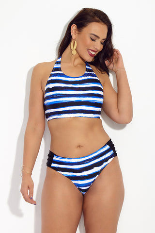 SKYE+ Suri Classic Hipster Bikini Bottom (Curves) - Tanami Blue Stripe Print Bikini Bottom | Tanami Blue Stripe Print| SKYE+ Suri Classic Hipster Bikini Bottom (Curves) - Tanami Blue Stripe Print. Features: Full coverage watercolor inspired plus size bikini bottom. Hipster style bottom to flatter curves and provide support. Wide ruched details at the hips for shaping. Tummy control panels visually slim torso. Mid rise fit provides full coverage while still looking stylish. Gold toned label at mid-back below seam. Perfect bottom to mix and match with prints or pair with a matching top.