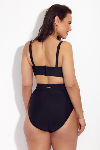 SKYE+ Waverly High Waist Bikini Bottom (Curves) - Black Bikini Bottom | Black| SKYE+ Waverly High Waist Bikini Bottom (Curves) - Black. Features: Classic black full coverage high waisted plus size bikini bottom. Ruched panels on hips for added shaping. Wide ruched details at the hips for shaping. Tummy control panels visually slim torso. High waist fit provides full coverage while still looking stylish. Gold toned label at mid-back below seam.