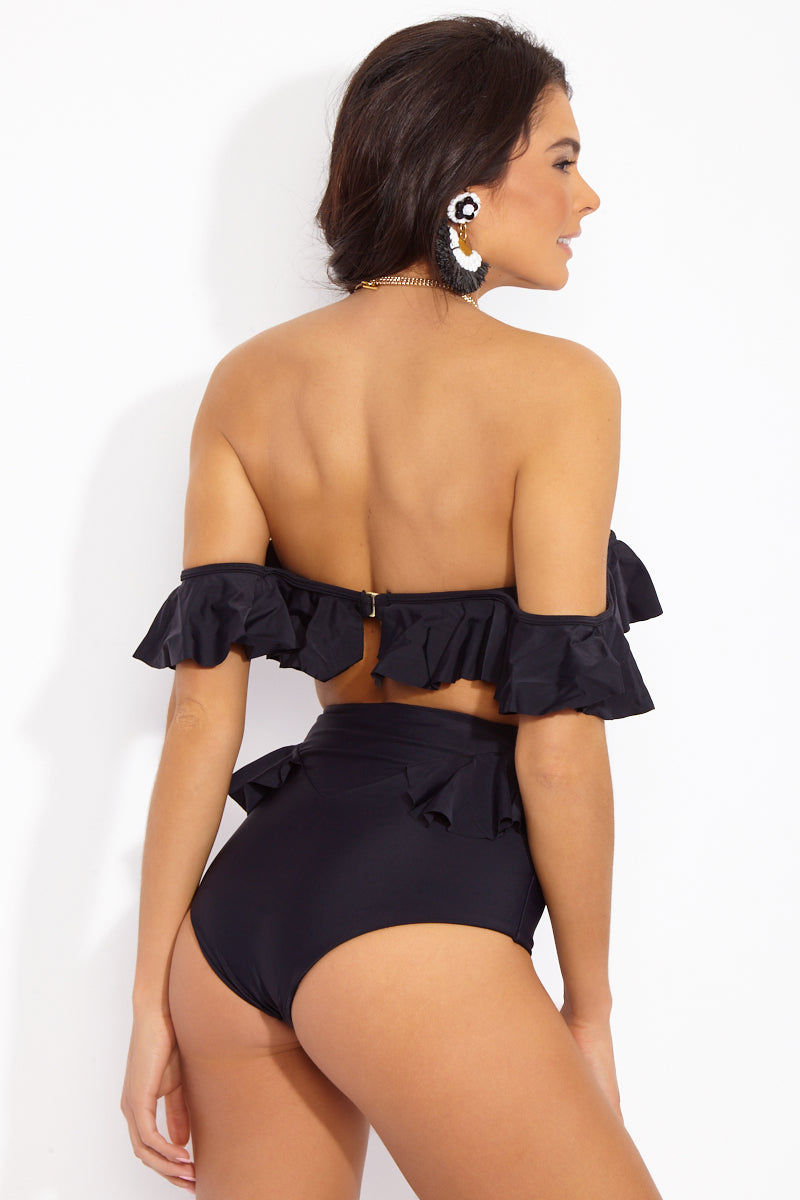 TORI PRAVER Tulum Ruffle High Waist Bikini Bottom - Black Bikini Bottom | Black| Tori Praver Tulum Ruffle High Waist Bikini Bottom - Black High-waisted black bikini bottom with ruffle detail at back. Retro-style high waist sculpts your curves, smoothes your tummy, and forms an hourglass shape. Feminine ruffle at back adds an adorably playful finish. Full coverage  Back View